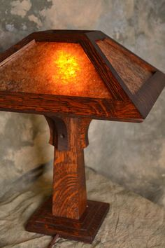 This lamp is one of many made and created in the time of the arts and crafts movement.   The lamp has been hand crafted and has the simple modern design the movement was all about.