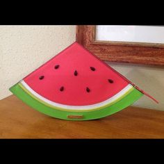 "Kate Spade Watermelon Clutch NWT Super Cute Kate Spade Watermelon Clutch!  ""Make a Splash"" with this conversation starter that is stylish and functional!  Fabric lined interior has 3 card slots.  Zip top closure and the seeds are black jewels.  At the widest points this clutch is 12"" x 7.5"" x 1.5""   Comes with a Kate Spade care card.  NWT  NO TRADES kate spade Bags Clutches & Wristlets"