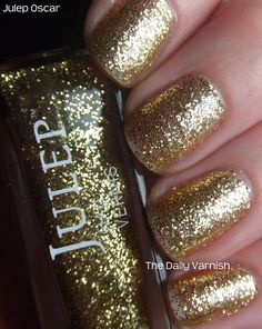 """Julep Oscar :: Gold glitter in clear base. 4 coats. Best as a top coat. Wears wear (although """"the formula isn't as fantastic as a stand alone polish"""") unlike OPI Gift of Gold which gets bad tip wear & flakes off in chunks."""