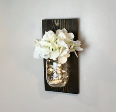 Single Wall Sconce. Hand crafted beautiful mason jar sconce. Very versatile use in any room in your home, office or give as a Gift, wedding gift, anniversary gift, birthday gift or hostess gift.  Imagine Decorating your wedding or event with these beautiful rustic sconces. They give such a warm inviting feeling.  Our sconces are beautifully hand crafted using lightly distressed Cedar wood. The wood is lightly sanded, stained and sealed or burnt in your choice of stain. The wall sconces are…
