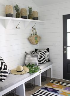 Black and white boho style mudroom with Aelfie flat weave rug from Dear Keaton online boutique