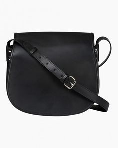 The Salli Lea saddle bag is made of black leather. The bag has an adjustable shoulder strap, a front flap with magnetic button closure and a frontal pocket underneath the flap. There is one zipper pocket on the inside. The bag is made from th Marimekko Bag, Beautiful Handbags, Black Leather Bags, Italian Leather, Cosmetic Bag, Saddle Bags, Bag Accessories, Shopping Bag, Shoulder Strap