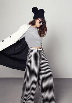 Supermodel Cara Grogan wearing Illesteva Holly Stripes in 48 Hour Magazine Sept 2013