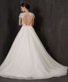 Calla Blanche 16108 Available at It's Your Day Bridal Boutique. 1661 Front Road, LaSalle, Ontario 519-978-5003