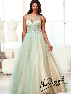 Bring out femininity in this ball gown. Its girly pastel color combinations looks really magical. Rhinestones sequins and illusion overlay all over the bodice and sweetheart bustline are some of the other details that you can look out for.