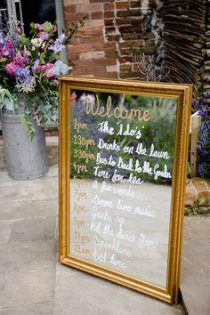 Gold guilt Mirror Order of The Day Sign | Back To The Garden Wedding Venue in Norfolk | Enchanted Garden Theme | Justin Alexander Bridal Gown | Pastel Bridesmaids | Lydia Stamps Photography | http://www.rockmywedding.co.uk/kerry-steve/