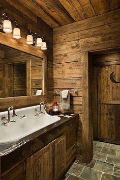 rustic bathroom- love the crescent moon on the door!