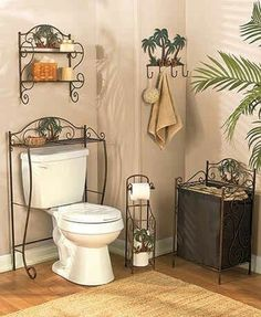 Create Your Own Personal Paradise When You Decorate With This Bronzed Palm Bath Collection These Utility Pieces Add Storage And Decor To Bathroom