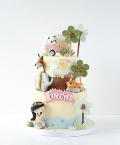 What would you get if you could take the safari animals to the beach? A panda in a pink campervan, an elephant squeezed into a rubber ring, and a leopard snoozing by the beach bar whilst a mermaid watches the glittering starfish. Baby Birthday Cakes, First Birthday Cakes, Fondant Cakes, Cupcake Cakes, Cake Designs For Kids, Beautiful Cake Designs, Safari Cakes, Jungle Cake, Heart Shaped Cakes