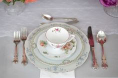 Vintage china rental company Plate provided the elegant mismatched china place settings.  We used a 4-piece setting including teacups, bread plate, salad, and dinner plates and had so much fun choosing which patterns to pair from the amazing assortment of china.