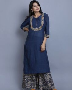 """A simplistic Khadi kurta detailed with Kalamkari and paired with an indigo mul Kalamkari palazzo. Salwar Neck Designs, Churidar Designs, Kurta Neck Design, Neck Designs For Suits, Kurta Designs Women, Dress Neck Designs, Blouse Designs, Kurta Patterns, Dress Patterns"