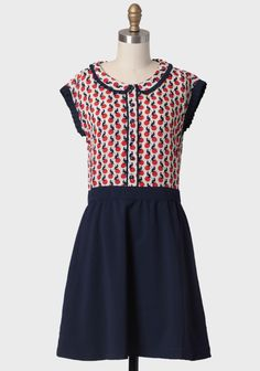 My cat lady uniform=Camille Printed Dress By Dear Creatures- this darling dress showcases red polka dots on cream with a navy cat pattern and solid navy skirt.
