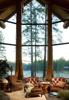 Edgewood Log Home via pinterest.  Tree trunk timbers, bluestone floor and tabletop, leather furniture - beautiful!