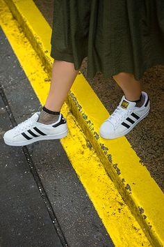 The Sneaker Every Fashion Girl Will Wear This Year #refinery29  http://www.refinery29.com/adidas-superstar-trends