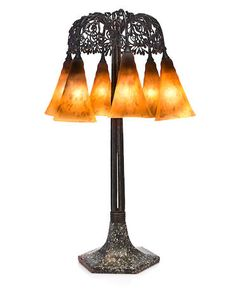 An Edgar Brandt and Daum Nancy wrought-iron, glass and porphyry Seaweed umbrella lamp circa 1920-21.