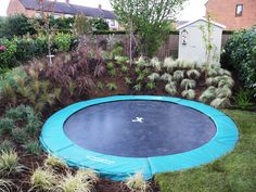 Garden Design With Trampoline much nicer than those big netted things. | future children :d