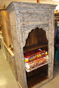 Antique bookcase that was salvaged from the Havelis of Rajasthan with a warm rustic wooden that defines character and age Wooden shelf unit bookcase will accent beautifully to any room. Wooden Shelf Unit, Wooden Shelves, Antique Bookcase, Antique Doors, Door Coffee Tables, Rustic Farmhouse Furniture, Rustic Cabinets, Wall Sculptures, Bookshelves