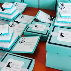 Unique Wedding Invitations in Tiffany Blue , Black and Silver. These Nautical Theme Wedding Exploding Box Invitations has a twisted Square Cake with Rhinestones and pop up floaties.