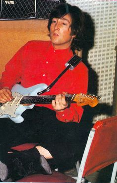 Rare 1965 picture of John playing a light blue Fender Stratocaster guitar. The Beatles Guitars.