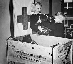 Members of the Junior American Red Cross packing children's sweaters for war refugees in Europe. Photograph, WW II: RED CROSS, Members of the Junior American Red Cross packing children's sweaters for war refugees in Europe. Refugees In Europe, Cross Pictures, Des Moines Iowa, Army Infantry, Pearl Harbor Attack, American Red Cross, History Photos, Destinations, Portraits