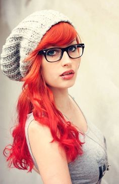 Cute orange hair, curled and with knitted beanie.
