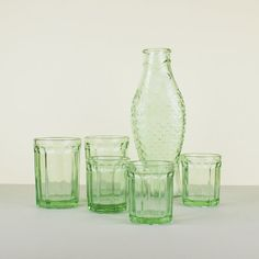 Green Glass Fish Carafe. This Fish & Fish collection is designed by Italian designer Paola Navone for Serax. Paola Navone was inspired by accessible products manufactured in the United Stated during the 1930s Great Depression. #kitchen #kitchenware #kitchenessentials #diningware #diningroom #decoration #interiordesign #design #fish #jug #decanter