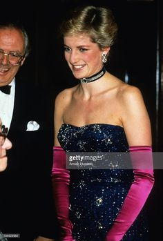 October 9, 1986: Diana Princess of Wales wearing a navy blue Murray Arbeid dress and shocking pink long gloves...