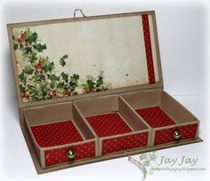 Tutorial.  Really cute box with endless possibilities for gifting things.  Ashley - great use of your score board and would make awesome teacher gifts. ;D