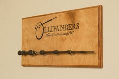 Harry Potter wand display for Ollivanders collectible wands and Universal Interactive wands. Can custom build display for up to 4 wands. Dimensions vary depending on how many wands you want to display. Hangable via two picture frame mounts on back of display.  If you would like to discus a custom order or have any other general questions, click on the Ask a question button. This display is made to your order and will require at least 7 days to make and ship.  Wands not included.