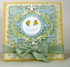 combo of robin's egg blue, some green grass with a dash of daffodil The Spellbinder dies are the Fleur de lis rectangle, label eighteen and Fleru de lis motifs.