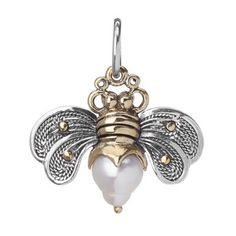 Gently landing where bravery and grace lie in your heart, (you know it does.) Honey pearl is sweet, and strong. Spreading words of encouragement wherever you go. Sterling Silver with Brass accents and a Fresh Water Honey Pearl. Charm is 3/4 inch Long