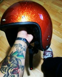 Orange helmet  Ando werewolf tattoo.