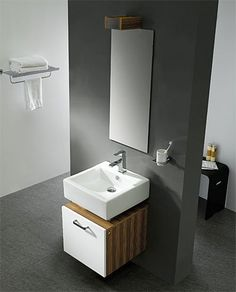 Vanity is just a cabinet mounted underneath wall mount.  I'm sure a hole is cut out of the top fpr plumbing.