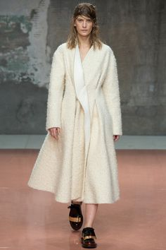 Look 28, Marni Fall 2014. If you can get past the wet birds-nest hair (seen throughout the show), this is a lovely wrap-coat
