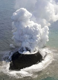 The mass of rock, pictured, was forced from the sea following an eruption on Wednesday 20 Dec 2013 in a region of the Pacific Ocean dubbed Ring of Fire....