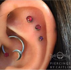 Ear Piercing Ideas For Females My healed daith and triple outer conch (flat) with anatometal garnets from Caitlin at Flesh Impressions in Broadbeach, QLD, Australia Triple Ear Piercing, Outer Conch Piercing, Flat Piercing, Piercing Tattoo, Different Ear Piercings, Cute Ear Piercings, Body Piercings, Conch Piercings, Unique Piercings