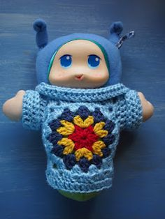 a very well dressed Glow Worm comfort toy - crochet made in Australia