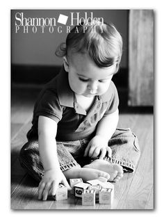 Toddler Photography. have the name on the bottom with the child holding the first letter of their name