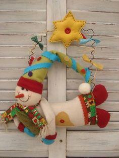 Boneco de Neve com 28 cm de largura. R$ 55,00