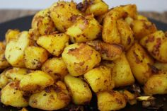 Potatoes - the best ever Indian Spiced Roasties. The perfect partner for any curry recipe or to spice up your Sunday Roast!Bombay Potatoes - the best ever Indian Spiced Roasties. The perfect partner for any curry recipe or to spice up your Sunday Roast! Indian Potato Recipes, Indian Food Recipes, Asian Recipes, Ethnic Recipes, Curry Recipes, Vegetarian Recipes, Cooking Recipes, Healthy Recipes, Bombay Potato Recipe