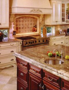 Marble countertop with the red wood. Like it.