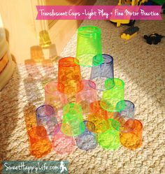 Stacking disposable colourful shot glasses and looking at the sun cast shadows with them.