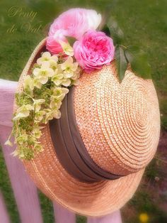 love the straw oater with pretty silk flowers - great accessory for spring and summer months!