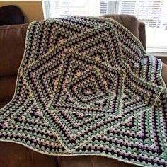 Interesting Granny square blanket! More Great Looks Like This