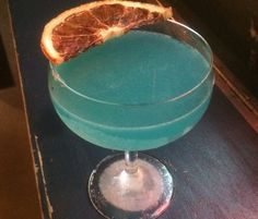 Corpse Reviver Blue -  Bombay Sapphire East gin, Lillet Blanc, blue curaçao​, lemon juice, a dash of Barspoon absinthe, and dehydrated orange peel - Madam Geneva in NYC