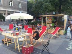 This pop-up library in Warsaw shows the simplicity of Lighter, Quicker, Cheaper Placemaking. A few folding chairs and paperback books combine with shaded table for a pleasant outdoor reading room experience! Organized by the Na Miejscu Foundation, Open Library, and Project for Public Spaces. #Placemaking #LQC #Libraries