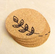 spring branch cork coaster....use coasters from Ikea and wood burning pen.