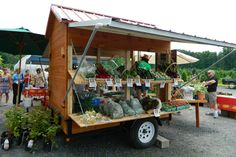 Great farm market setup.  A trailer you can open and display vegetables.