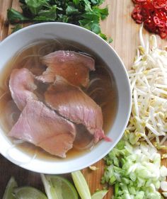 Easy homemade beef pho.  OMG, easy and delicious.  Add some onions and ginger into the broth.  I like to add the a little of the hot chilli sauce too, and use bean thread noodles.  Delicious!  Don't forget to add a squeeze of lime!