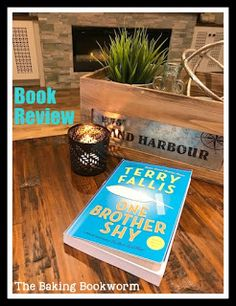 Book Review: One Brother Shy by Canadian author Terry Fallis. A story about a man trying to find himself as he struggles with his personal demons. Witty and full of heart. This is a great read. Full review on my blog, The Baking Bookworm. #terryfallis #canadian #fiction #canlit